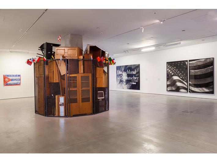 //Motherland in Art// exhibition. Foreground: Jarosław Kozłowski, //A United World – the Totalitarian Version//, 2000. Background, works by: Damir Muratov, Katharina Sieverding, Robert Longo, photo: R. Sosin