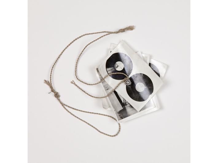 Milan Knížák, //Fly//, 1987, photograph, screw, string, 13.5 × 13.5 cm, MOCAK Collection