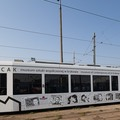 An MPK tram with a MOCAK advertisement, //Young Cracow Painters by Pola Dwurnik//205