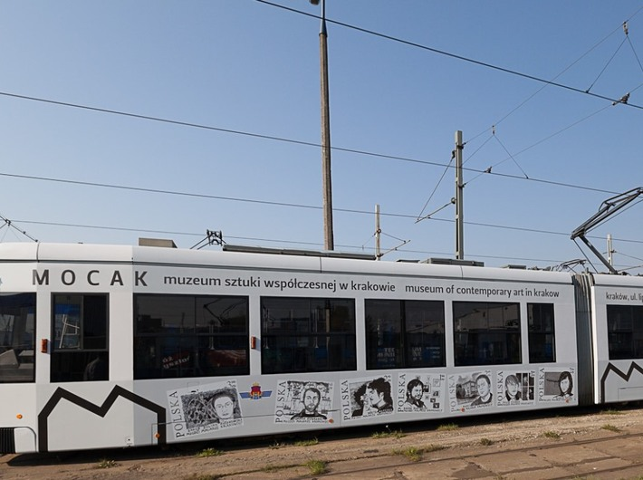An MPK tram with a MOCAK advertisement, //Young Cracow Painters by Pola Dwurnik//