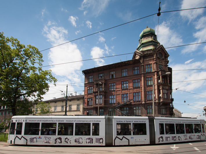 An MPK tram with a MOCAK advertisement, //Young Cracow Painters by Pola Dwurnik// - 2